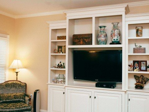 White bookcase and entertainment center